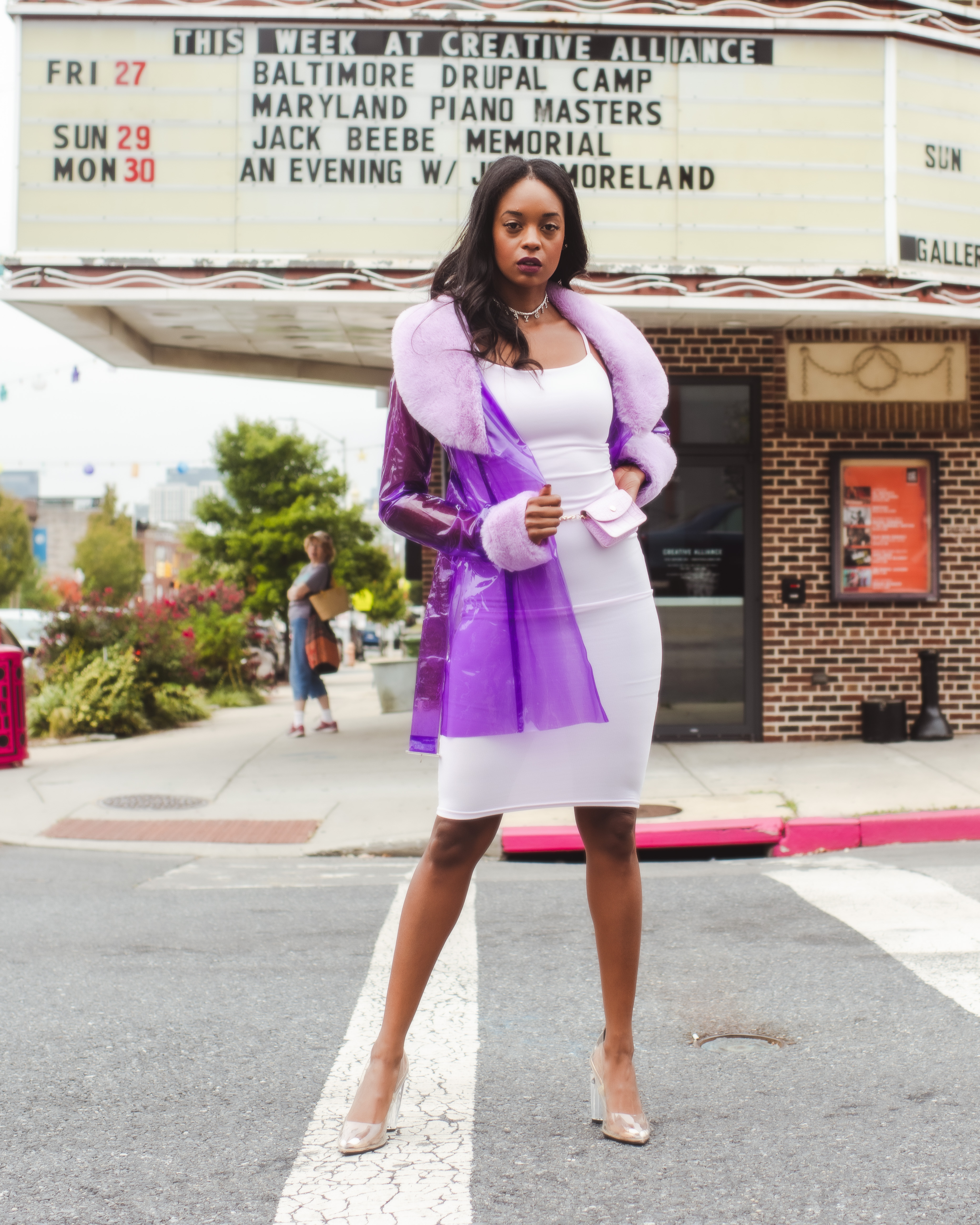 Woman in purple trench coat and purple slip dress