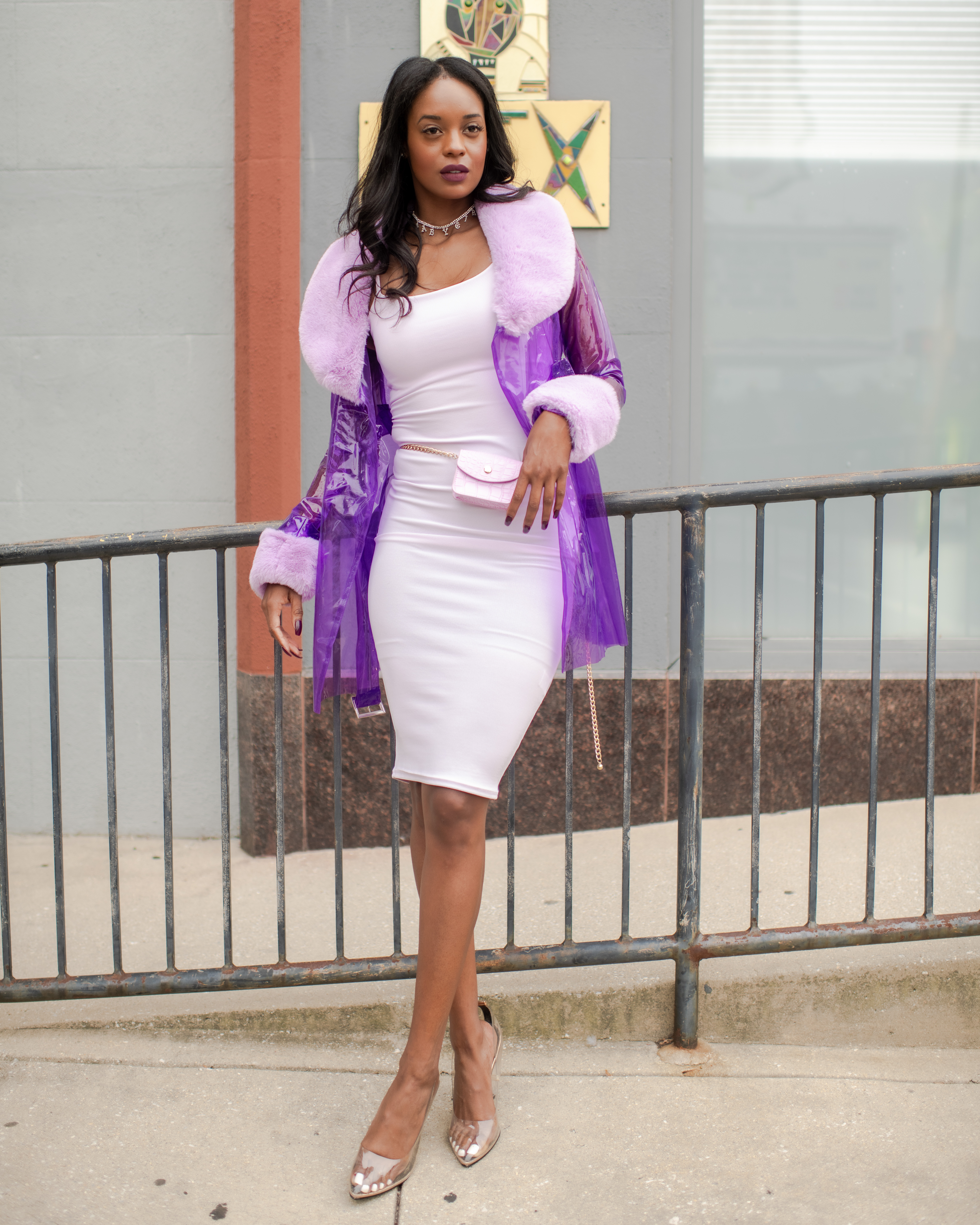 Woman in purple trench coat and slip dress